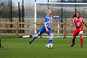 Kirsty Barton makes a long pass during the FA Women's Premier League match between Brighton Ladies and Cardiff City Ladies at Brighton's Training Ground, Lancing, United Kingdom on 22 March 2015. Photo by Geoff Penn.