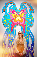 Roslyn, New York, U.S. September 13, 2019. LAURIE GRAB poses in front of large butterfly Animodules at ANIMODULES Agents of Peace exhibit Farewell Reception and Founders' talk by GARY BARAT and CHANDRI BARAT, at the Nassau County Museum of Art's Manes Art & Education Center, named for Dr. HARVEY MANES, who was in attendance and spearheaded the exhibit.