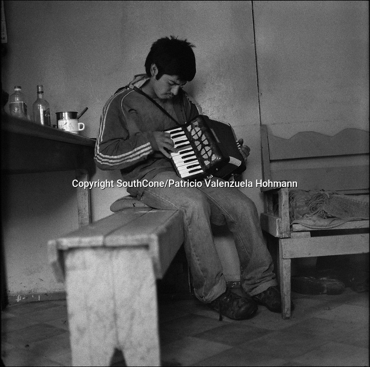 Atanasio practices on his accordion.<br />  In Chile`s western Patagonia the Balseros (boatmen) of the Baker river are in danger of loosing it`s ways of work as the last  families that live on logging (only dead trees logging permitted by law) move their production using the river as a highway and natural landscape are threaten by the &quot;Hydroaysen Project&quot;, a $3 billion project which plans to build five dams in Patagonia rivers, two of  them in the Baker river, flooding thousands of hectares and building a 3.000 km. long transmission line which will send energy to the huge northern Chilean mining industry destroying one of the world most pristine and untouched natural areas of the planet. As South America holds one of the worlds biggest water resources of the planet first world companies such as the Italian ENEL, the Spanish Endesa, among others want to put their hands on them. By corporate lobbing they promote state corruption, divide communities and lie to citizens as new clean energy generating ways are taking the lead around the globe they promote old, destructive and obsolete energy generating ways.