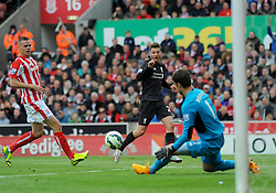 Liverpool's Adam Lallana attempts a shot at goal - Photo mandatory by-line: Nizaam Jones/JMP - Mobile: 07966 386802 - 24/05/2015 - SPORT - Football - Stoke - Britannia Stadium - Stoke City v Liverpool - Barclays Premier League