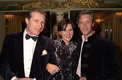 Left to right, MR MARK THOMPSON, his sister LADY IVAR MOUNTBATTEN and MR PETER THOMPSON, at a ball in London on 30th October 2000.OIL 22