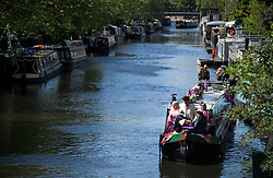 © Licensed to London News Pictures. 04/05/2019. London, UK. Canalway Cavalcade festival in Little Venice, West London on Saturday, May 4th 2019. Inland Waterways Association's annual gathering of canal boats brings around 130 decorated boats together in Little Venice's canals on May bank holiday weekend. Photo credit: Ben Cawthra/LNP
