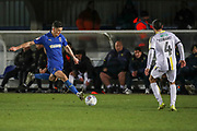 AFC Wimbledon midfielder Callum Reilly (33) about to pass the ball during the EFL Sky Bet League 1 match between AFC Wimbledon and Burton Albion at the Cherry Red Records Stadium, Kingston, England on 28 January 2020.