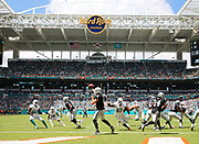 Sep 23, 2018; Miami Gardens, FL, USA; Oakland Raiders quarterback Derek Carr (4) throws a pass at Hard Rock Stadium between the Miami Dolphins and the Oakland Raiders. The Dolphins defeated the Raiders 28-20. (Steve Jacobson/Image of Sport)