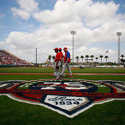 March 9, 2011; Lakeland, FL, USA; Philadelphia Phillies shortstop Jimmy Rollins (11), manager Charlie Manuel and first baseman Ryan Howard (6) walk across the field before a spring training exhibition game against the Detroit Tigers at Joker Marchant Stadium.  Mandatory Credit: Derick E. Hingle-US PRESSWIRE