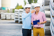 Male architects inspecting inventory at site