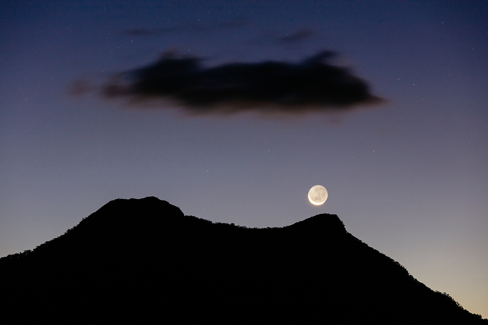 A full moon rising above the silhouette of Mount Maroon in the Scenic Rim area of southern Queensland.