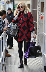BBC Radio 1 presenter Fearne Cotton wearing a red and black coat, covering her baby bump and carrying bags . London. UK. 04/10/2012<br />BYLINE MUST READ : GOTCHAIMAGES.COM<br /><br />Copyright by © Gotcha Images Ltd. All rights reserved.<br />Usage of this image is conditional upon the acceptance <br />of Gotcha Images Ltd, terms and conditions available at<br />www.gotchaimages.com