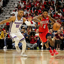 Oct 19, 2018; New Orleans, LA, USANew Orleans Pelicans guard Elfrid Payton (4) drives past Sacramento Kings guard Frank Mason III (10) during the first half at the Smoothie King Center. The Pelicans defeated the Kings 149-129. Mandatory Credit: Derick E. Hingle-USA TODAY Sports
