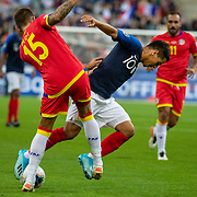 PARIS, FRANCE - September 10:  Wissam Ben Yedder #10 of France is tackled by Moisés San Nicolás #15 of Andorra  during the France V Andorra, UEFA European Championship 2020 Qualifying match at Stade de France on September 10th 2019 in Paris, France (Photo by Tim Clayton/Corbis via Getty Images)
