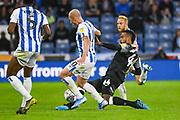 Tom Huddlestone of Derby County (44) tackles Aaron Mooy of Huddersfield Town (10) during the EFL Sky Bet Championship match between Huddersfield Town and Derby County at the John Smiths Stadium, Huddersfield, England on 5 August 2019.