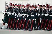 Officer cadets marching at their passing out graduation parade at Sandhurst Military Academy, Sandhurst, Surrey