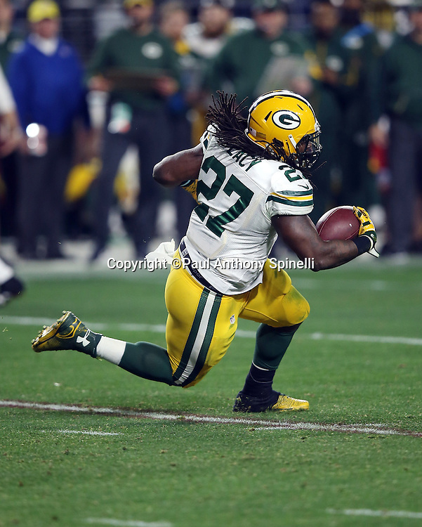 Green Bay Packers running back Eddie Lacy (27) slips as he runs for a third quarter gain of 14 yards during the NFL NFC Divisional round playoff football game against the Arizona Cardinals on Saturday, Jan. 16, 2016 in Glendale, Ariz. The Cardinals won the game in overtime 26-20. (©Paul Anthony Spinelli)