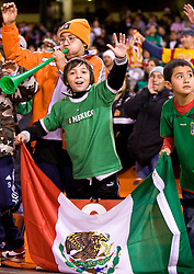 February 24, 2010; San Francisco, CA, USA;  A young Mexican fan cheers on the Mexico National team before the game against Bolivia at Candlestick Park. Mexico defeated Bolivia 5-0.