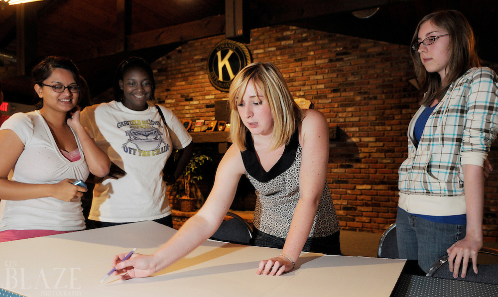 Richmond Heights Key Club President Katie Behra, flanked by members Tulsi Patel, Andrea West and Allison Tuckerman, works on a fundraising project while at their weekly meeting at the Kiwanis Lodge in Richmond Heights, Ohio on Thursday September 18, 2008.