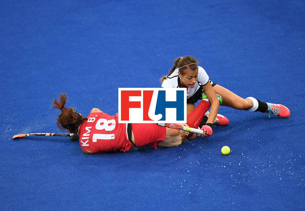 South Korea's Kim Bomi (L) falls over Germany's Selin Oruz during the women's field hockey Germany vs South Korea match of the Rio 2016 Olympics Games at the Olympic Hockey Centre in Rio de Janeiro on August, 10 2016. / AFP / MANAN VATSYAYANA        (Photo credit should read MANAN VATSYAYANA/AFP/Getty Images)