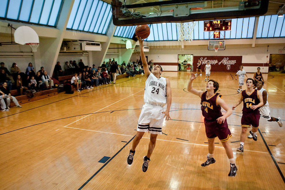 December 10, 2010 - Bronx, NY : Horace Mann senior Matthew Elmore, center, lays up the ball during the Lions' 60-40 defeat of Loyola on Dec. 10. The game was part of the school's annual Peg Duggan basketball tournament.