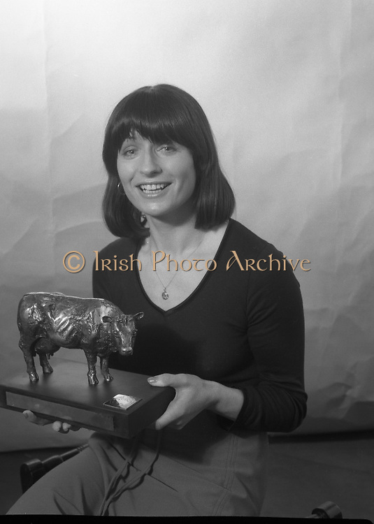 1980-02-19.19th February 1980.19-02-1980.02-19-80..The Bronze Cow:..Photographed at: location unspecified..Irene Cunningham, Ranks (I) Ltd,  holding the Bronze Cow Trophy  due to be awarded at the Munster Dairy Farmer of the Year event. The trophy is the work of Rowan Gillespie who is also responsible for the GAA All Star trophies.
