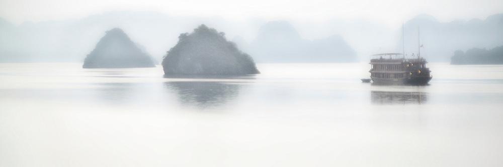 First light on Ha Long Bay, fog and mist.