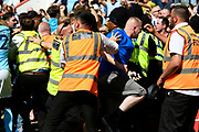Stewards pushing back celebrating Manchester City fans after Raheem Sterling (7) of Manchester City scored the winner during the Premier League match between Bournemouth and Manchester City at the Vitality Stadium, Bournemouth, England on 26 August 2017. Photo by Graham Hunt.