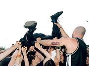 Group of people moshing at a concert