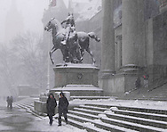 People on the steps of the Museum of Natural History<br /> during a snow storm<br /> New York City, U.S.A. Winter in New York