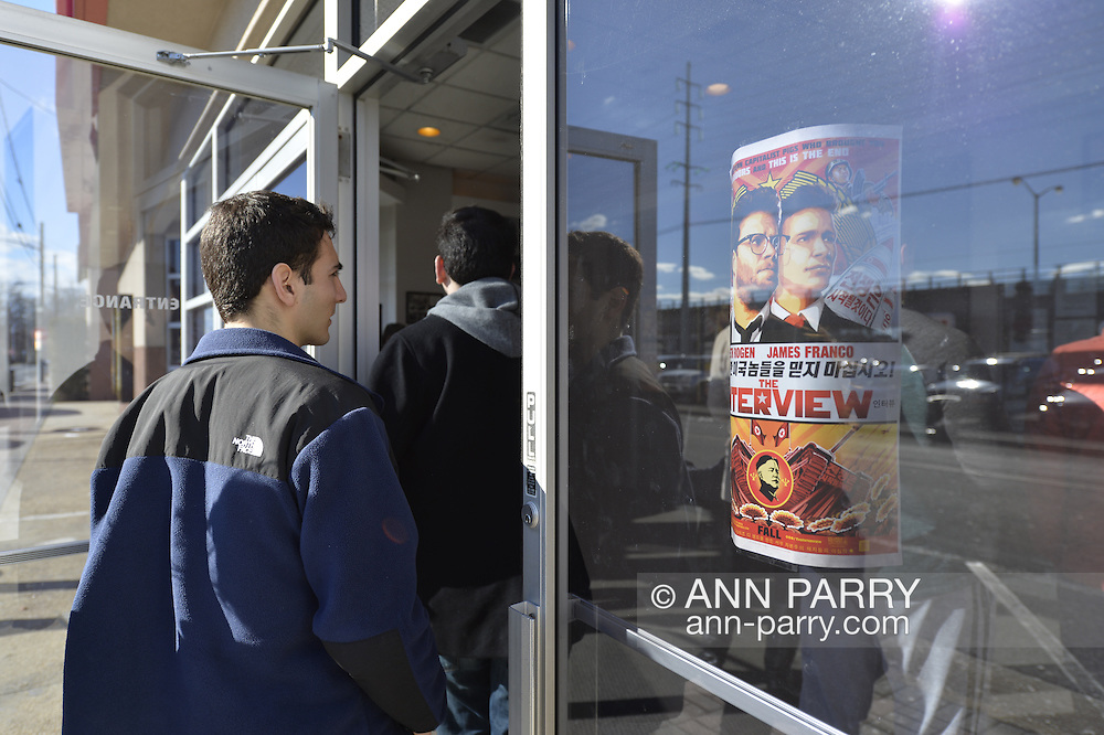 Merrick, New York, USA. December 25, 2014. The Interview, the controversial comedy by Sony Pictures Entertainment, plays at Merrick Cinemas, thought to be the only movie theater showing it in Nassau County, Long Island, on Christmas Day. In November, hackers hacked Sony Pictures computers, and later threatened theaters planning to show The Interview, in which stars James Franco and Seth Rogen play civilians recruited by CIA to assassinate North Korea dictator Kim Jong-un. Due to the terrorist threats, Sony originally canceled public release of the film, but then changed its plans again, and released the film in a limited way, including several hundred independent theaters, against the attempt to suppress the American First Amendment Right to Free Speech.
