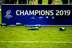 Empty Champaign bottles are left on the floor by the Champions board after Saracens celebrate winning the Heineken Champions Cup after beating Leinster Rugby in the Final - Mandatory by-line: Robbie Stephenson/JMP - 11/05/2019 - RUGBY - St James' Park - Newcastle, England - Leinster Rugby v Saracens - Heineken Champions Cup Final