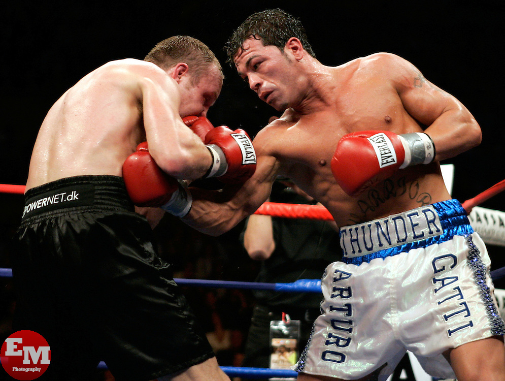 Arturo Gatti (r) and Thomas Damgaard (l) trade punches during their 12 round fight for the IBA Welterweight Championship at Boardwalk Hall in Atlantic City, NJ.  Gatti won the bout via 11th round knockout.