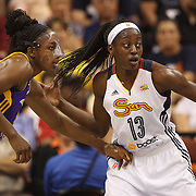 Sisters Chiney Ogwumike, Connecticut Sun and Nneka Ogwumike, Los Angeles Sparks, (wearing face mask), playing against each other for the fist time in the WNBA during the Connecticut Sun Vs Los Angeles Sparks WNBA regular season game at Mohegan Sun Arena, Uncasville, Connecticut, USA. 3rd July 2014. Photo Tim Clayton