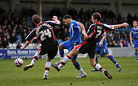 Photo: Tony Oudot/Richard Lane Photography. Gillingham v Shrewsbury Town. Coca-Cola Football League Two. 28/02/2009. <br /> Andrew Barcham of Gillingham goes past Cansdell-Sherriff and Darren Moss of Shrewsbury