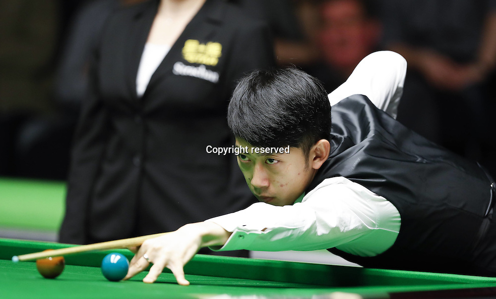 23.11.2016. York, Yorkshire, England.  Chen Zhe of China competes during the first round match with Mark Allen of Northern Ireland at the Snooker UK Championship in York, Britain on Nov. 23, 2016. Chen lost 4-6.