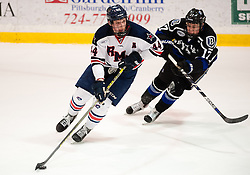 March 12 2016: Robert Morris Colonials forward Brandon Denham (44) skates with the puck while being pursued by Bentley Falcons forward Jake Ahlgren (17) during the second period in game two of the Atlantic Hockey quarterfinals series between the Bentley Falcons and the Robert Morris Colonials at the 84 Lumber Arena in Neville Island, Pennsylvania (Photo by Justin Berl)