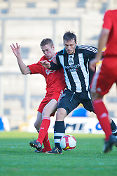WARRINGTON, ENGLAND - Wednesday, April 29, 2009: Liverpool's Stephen Darby in action against Newcastle United's Francisco Jimenez Tejada during the FA Premiership Reserves League (Northern Division) match at the Halliwell Jones Stadium. (Photo by David Rawcliffe/Propaganda)