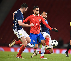Scotland's Scott McKenna and Scotland's Matt Phillips both tackle Costa Rica's Yendrick Ruiz during the international friendly match at Hampden Park, Glasgow.RESTRICTIONS: Use subject to restrictions. Editorial use only. Commercial use only with prior written consent of the Scottish FA.
