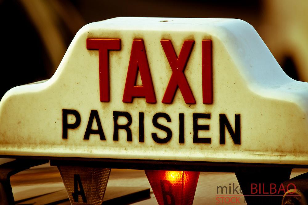 Taxi sign.<br /> Paris, France.