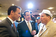 Albertson, New York, U.S. 26th October 2013. New York Governor ANDREW CUOMO endorses TOM SUOZZI for Nassau County Executive, at the Albertson Veterans of Foreign Wars VFW Post. Democrat Suozzi, the former Nassau County Executive, and Republican incumbent Mangano face each other in a rematch in the upcoming November 5th election.