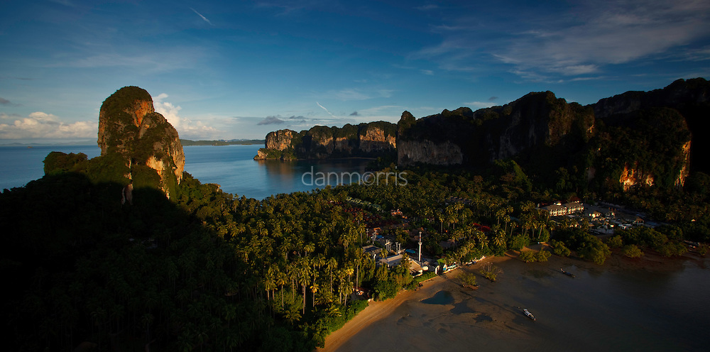 Hat Tham Phra Nang Peninsula houses Rai Lay Beach, Phra Nang Beach, and is world famous for rock climbing on beautiful limestone towers.  Krabi Province, Thailand
