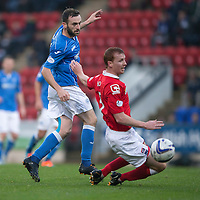St Johnstone v Ross County....22.11.14   SPFL<br /> James McFadden playes the ball through the legs of Scott Boyd<br /> Picture by Graeme Hart.<br /> Copyright Perthshire Picture Agency<br /> Tel: 01738 623350  Mobile: 07990 594431