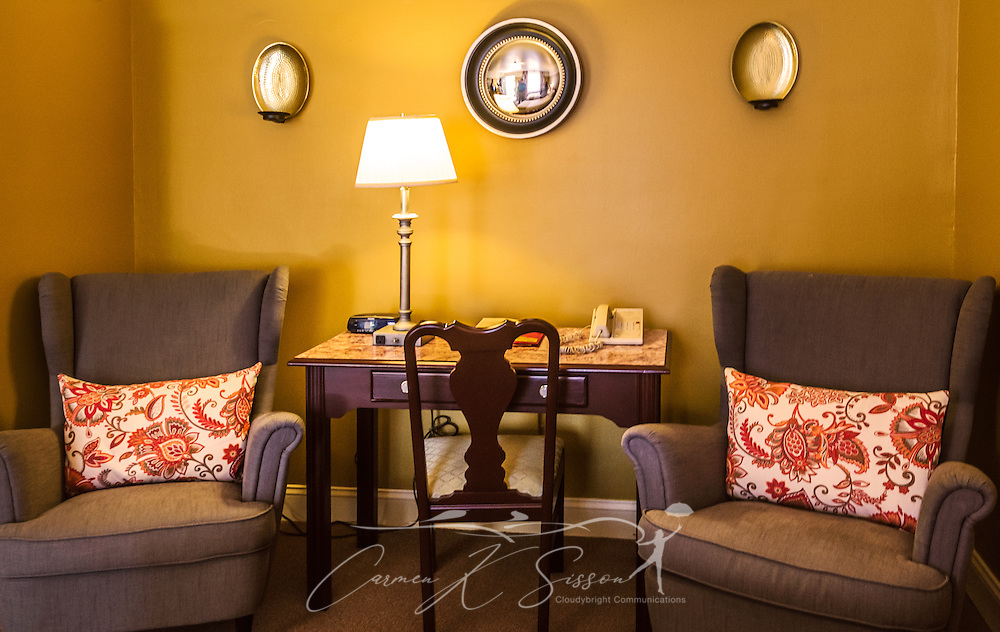 """A sitting area provides a focal point in one of the newly-remodeled rooms at University Inn, a family-owned hotel located near Emory University in Atlanta, Georgia, May 29, 2014. The inn opened in January 1971 and offers 60 rooms to meet the lodging needs of University parents and other Atlanta visitors. It was featured on the Travel Channel's """"Hotel Impossible,"""" May 26, 2014. (Photo by Carmen K. Sisson/Cloudybright)"""