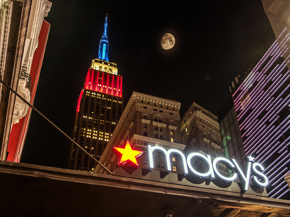 Empire State Building & Macy's Herald Square at night with the moon