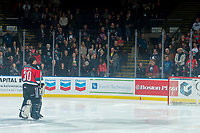 KELOWNA, CANADA - DECEMBER 2: Roman Basran #30 of the Kelowna Rockets stands on the ice during the national anthem against the Kootenay Ice on December 2, 2017 at Prospera Place in Kelowna, British Columbia, Canada.  (Photo by Marissa Baecker/Shoot the Breeze)  *** Local Caption ***