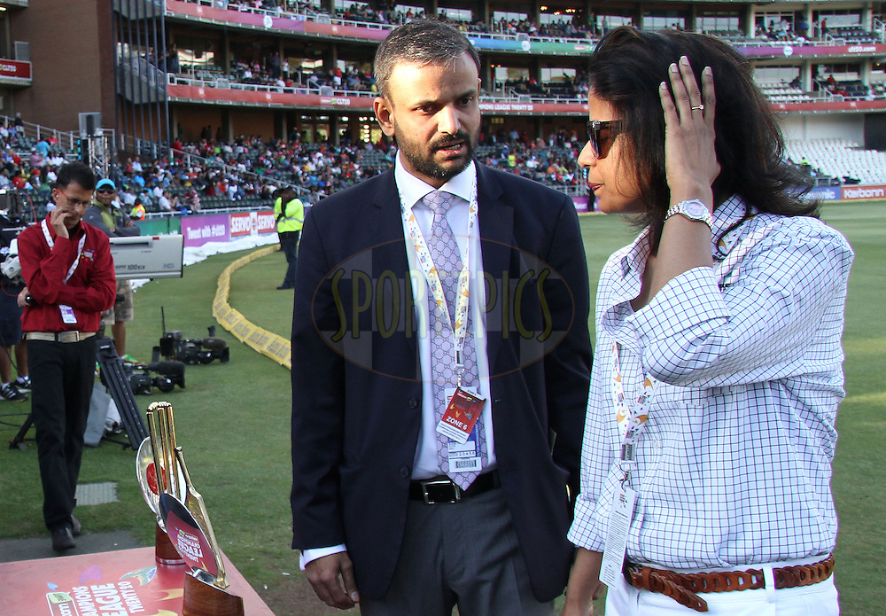 Sundar Raman (CLT20) chats to Nidhi Choudhary (CLT20) during the Final of the  Karbonn Smart CLT20 South Africa between the Sydney Sixers and the Highveld Lions  held at The Wanderers Stadium in Johannesburg, South Africa on the 28th October 2012..Photo by Shaun Roy/SPORTZPICS/CLT20
