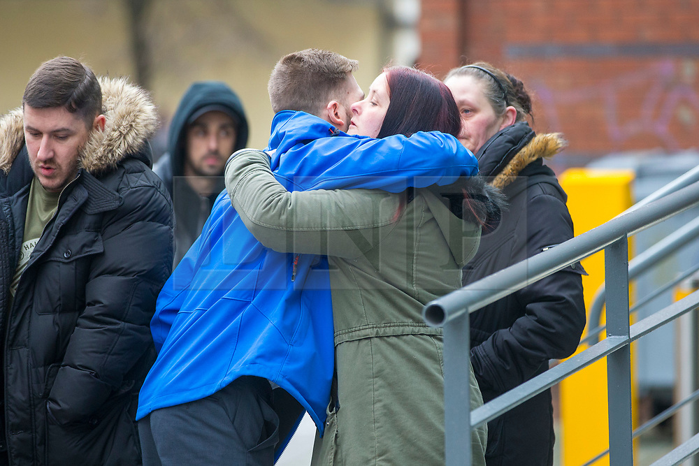"""© Licensed to London News Pictures. 05/02/2018. Liverpool, UK. Tom Evans (centre, blue coat) father of Alfie Evans is greeted by reporters as he arrives at Liverpool Civil & Family Court this morning. Tom Evans and Kate James from Liverpool are in dispute with medics looking after their son 19-month-old son Alfie Evans, at Alder Hey Children's Hospital in Liverpool. Alfie is in a """"semi-vegetative state"""" and had a degenerative neurological condition doctors have not definitively diagnosed. Specialists at Alder Hey say continuing life-support treatment is not in Alfie's best interests but the boy's parents want permission to fly their son to a hospital in Rome for possible diagnosis and treatment. Photo credit: Andrew McCaren/LNP"""