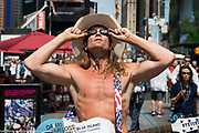 The Naked Cowboy watching for the solar eclipse as seen in Times Square in New York City, NY on August 21, 2017.