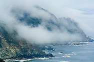 Coastal fog and mountain cliffs over the Pacific Ocean along the Big Sur Coast, Monterey County, California