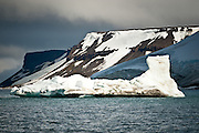 An iceberg floats in Tikhaya Bay in Franz Josef Land, Russian Arctic.