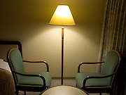 two chairs in a hotel room facing each other
