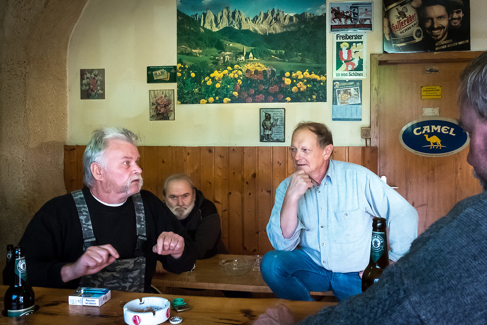 Germany - Deutschland - Saxony - Sachsen after the federal elections - AFD supporters in a backroom of a former gas station - Here: Peter Hampel (right - blue shirt), owner of the club - with his friends drinkinbg beer ... Oppach, Saxony, 26.09.2017; © Christian Jungeblodt