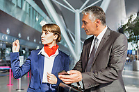 Passenger service agent assisting passenger to his gate in airport